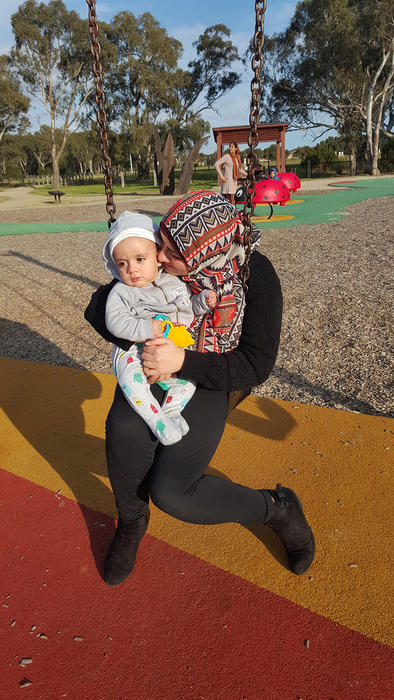 Afaf Alfawwal plays with her and her son, Zachariah in the park.