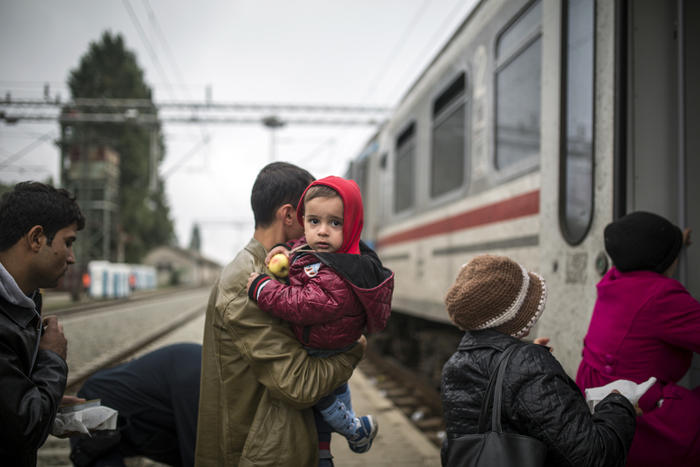 Refugees primarily from Syria, Iraq and Afghanistan board train at Tovarnik railway station in Croatia for transportation to Hungary on their way to Germany.