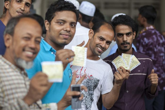 Hundreds of devotees wait to buy train tickets to head home for Eid in a station in Dhaka, Bangladesh.