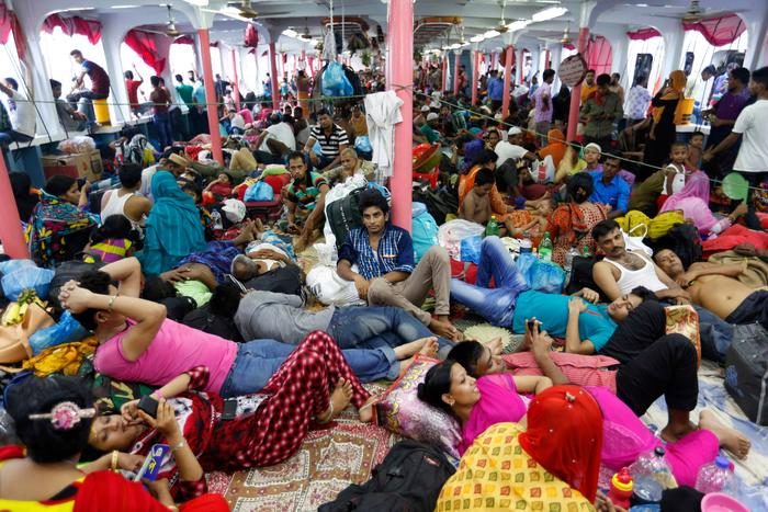 Bangladeshis rest inside a crowded ferry to travel to their hometowns for Eid al Adha in Dhaka, Bangladesh.