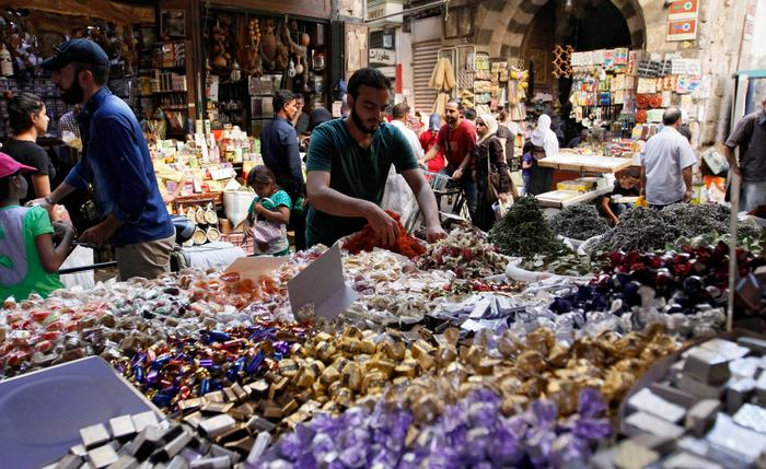 Syrians shop for Eid al-Adha holiday in a market in the Old City of Damascus, Syria