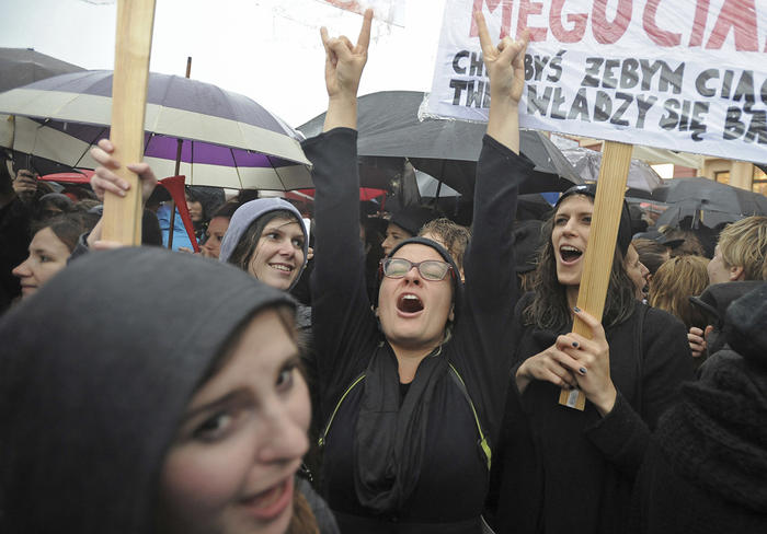 100,000 women took part in a Black Monday strike in Poland to protest a proposed abortion ban  (AP Photo/Alik Keplicz)