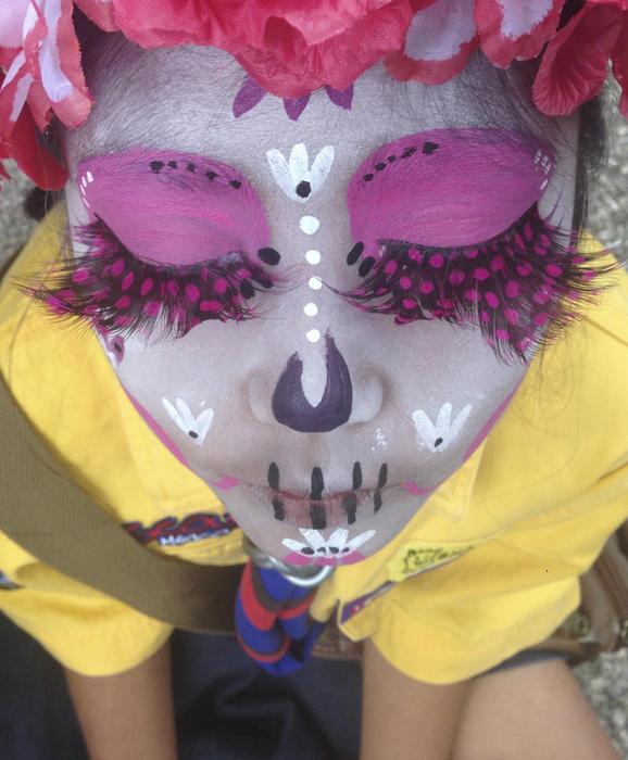 Girl scout Luna Hernandez, 9, dressed as a Catrina