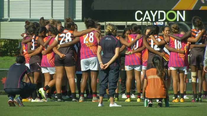 The Woomeras players gather during a game in Melbourne.