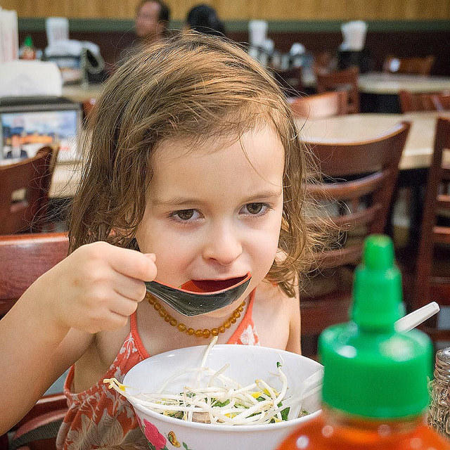 Girl eating Pho