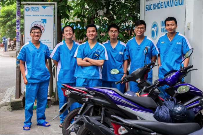 """""""LGBT is normal"""": The Men's Health Vietnam team pictured outside their clinic. Photo by Jeremy Smart."""
