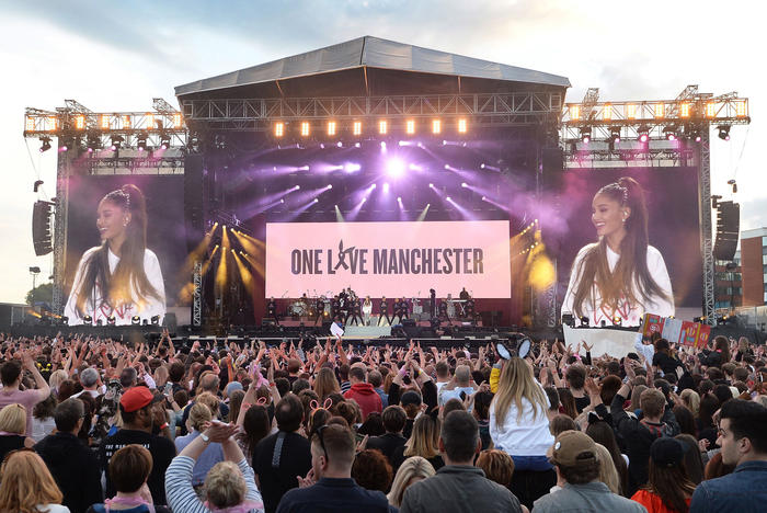 Ariana Grande, centre in white, performs at the One Love Manchester tribute concert in Manchester, north western England, Sunday, June 4, 2017.