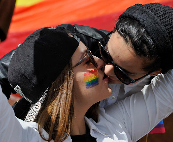 Revelers take part in the Gay Pride Parade in Bogota, on July 3, 2016. / AFP / GUILLERMO LEGARIA        (Photo credit should read GUILLERMO LEGARIA/AFP/Getty Images)