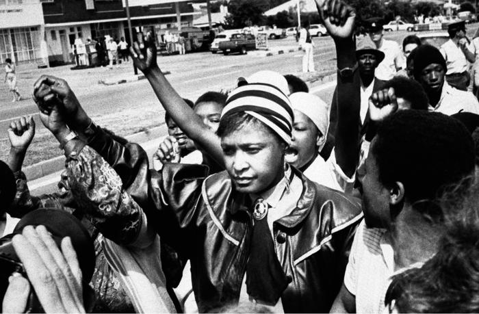 Winnie Mandela is cheered by supporters after appearing in the Krugersdorp Magistrate's court