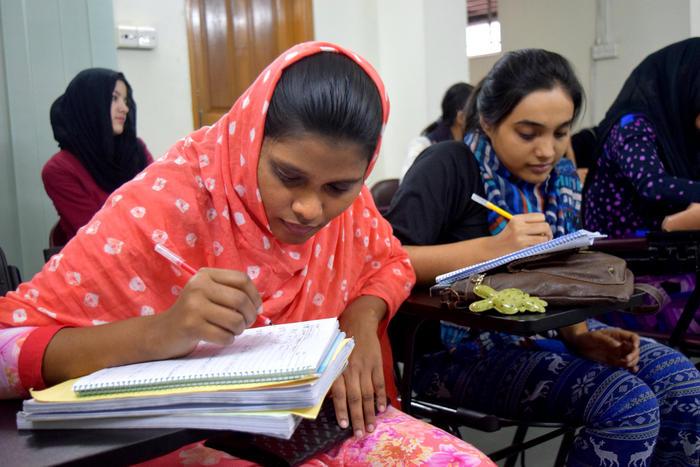 Students hard at work, studying at AUW in Bangladesh.