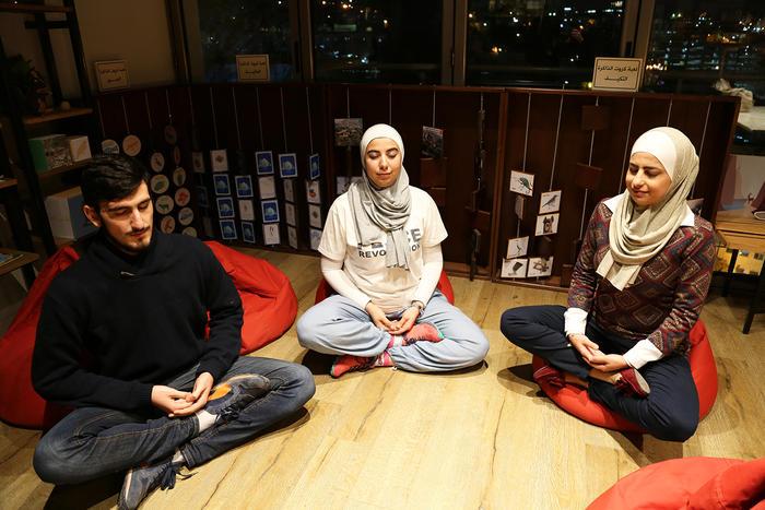 (L to R) Meditator, Fares Akasheh and mediation trainers, Nesreen Khashman and Aseel Nassar.