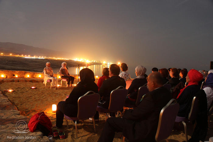 Mediation trainers lead the supermoon mediation beside the Dead Sea.