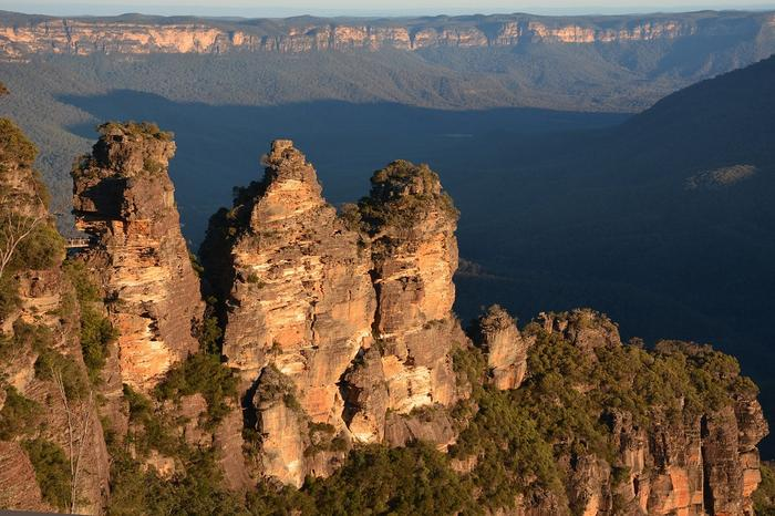 a photo with the three sisters cliffs in blue mountains