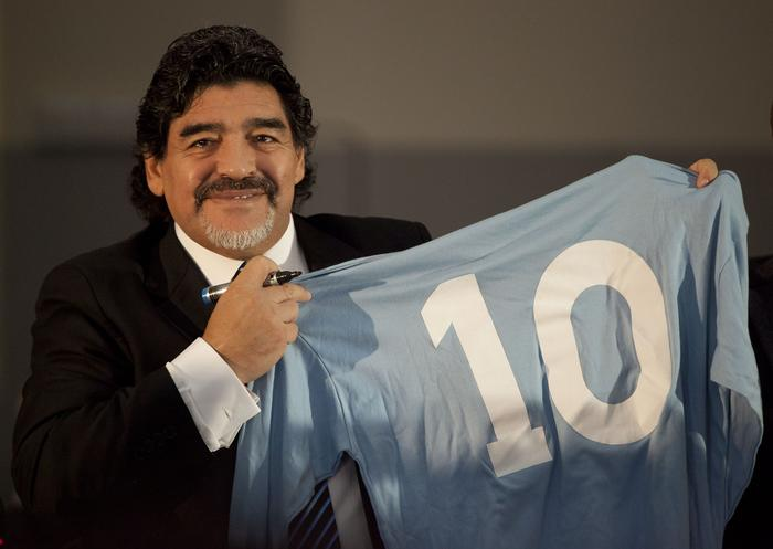 Football legend Argentinian Diego Maradona with a SSC Napoli number 10 jersey during a press conference on February 26, 2013 in Naples.