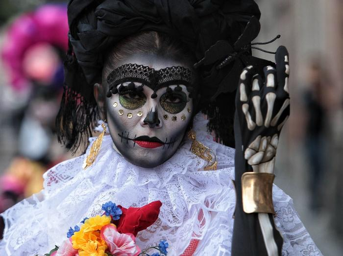 A woman dressed and painted as Mexican popular character Catrina