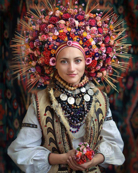 A woman wears a floral crown