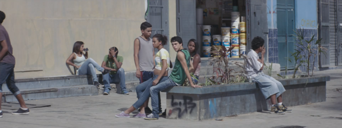 Elder hanging out on a street corner with his crew.