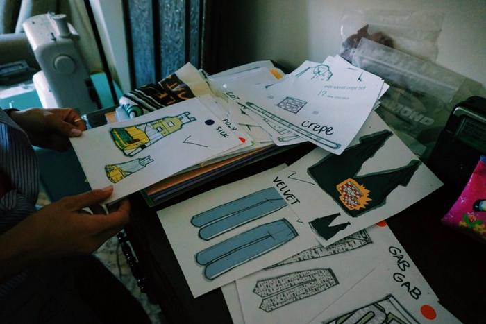 Jordanian designer, Tania Haddad calls on the help of Syrian refugees to bring her drawings to life in garment form.