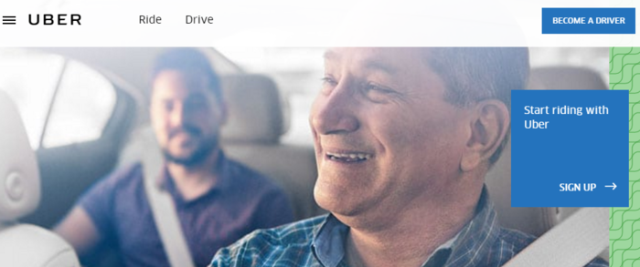 An Uber driver smiles on the company's website,