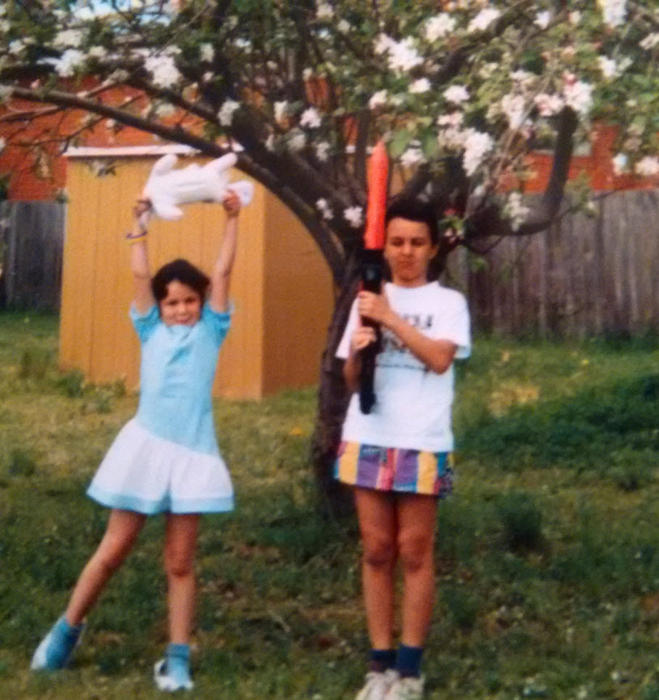 Assia Benmedjdoub and Ilias Benmedjdoub in the backyard of their first Australian home in the western suburbs of Sydney