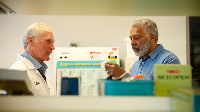 Ernie Dingo in the lab with Dr John Mitchell