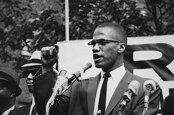 1963:  American civil rights leader Malcolm X (1925 - 1965)  at an outdoor rally, probably in New York City.