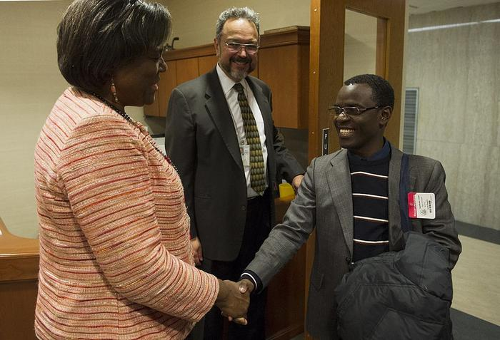 Linda Thomas-Greenfield (L) greets Ugandan gay rights activist Frank Mugisha during a meeting at the State Department on February 27, 2014 in Washington, DC. AFP PHOTO/Mandel NGAN        (Photo credit should read MANDEL NGAN/AFP/Getty Images)