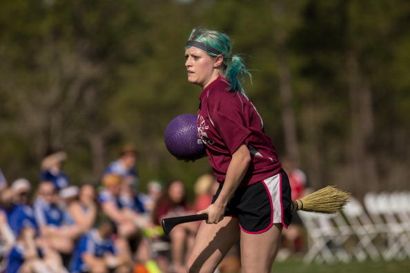 A woman competes in the Quidditch World Cup.