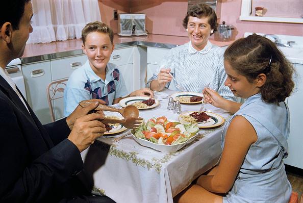 Family Eating Dinner in Kitchen
