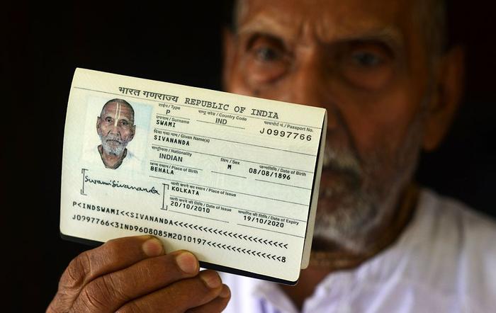 Swami Sivananda shows off his passport
