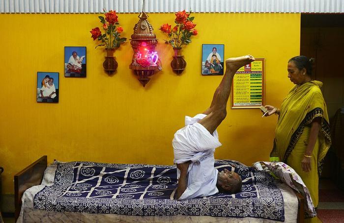 Indian monk Swami Sivananda practices yoga