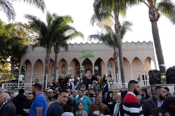 Muslim residents of the Western Sydney leave after their Eid al Adha prayer outside the Lekamba mosque.