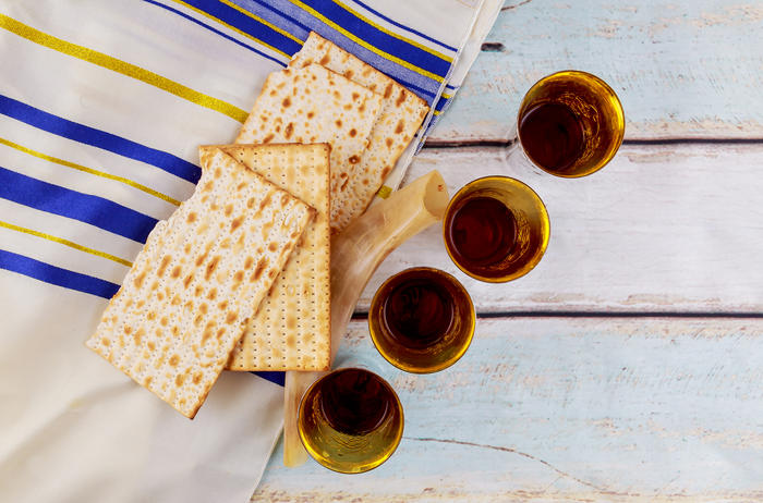 Wine and matzoh - elements of Passover supper.