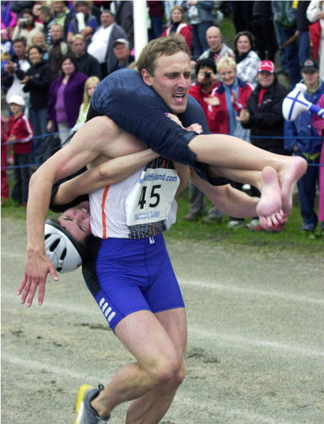 Estonia's Madis Uusorg and his wife Inga race in the Wife-carrying World Championships.
