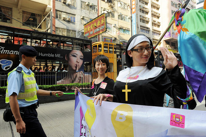 A rally participant dressed as nun takes