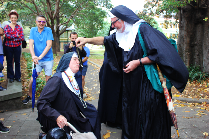 Sister Catheter of the Sacred Immaculate Ejaculate, who rose to the rank of sister only a month before, kisses the sacred relic.