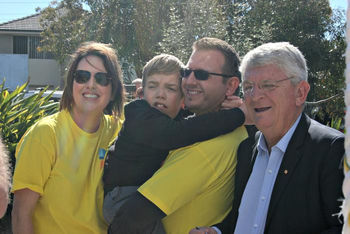 Caroline Ghatt, Tim Smith and their son Marcus celebrate the playground opening with Northern Beaches Council administrator Dick Persson