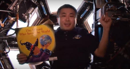 Astronaut Koichi Wakata reads a child's book from space.