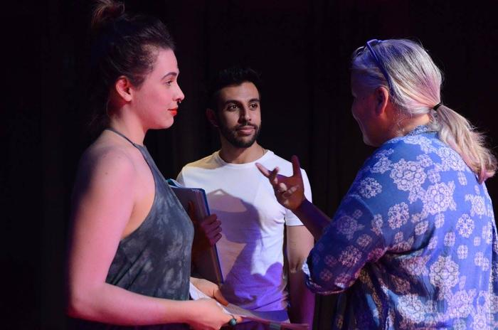 Director Suzanne Millar talks to actors during rehearsals for The Laden Table