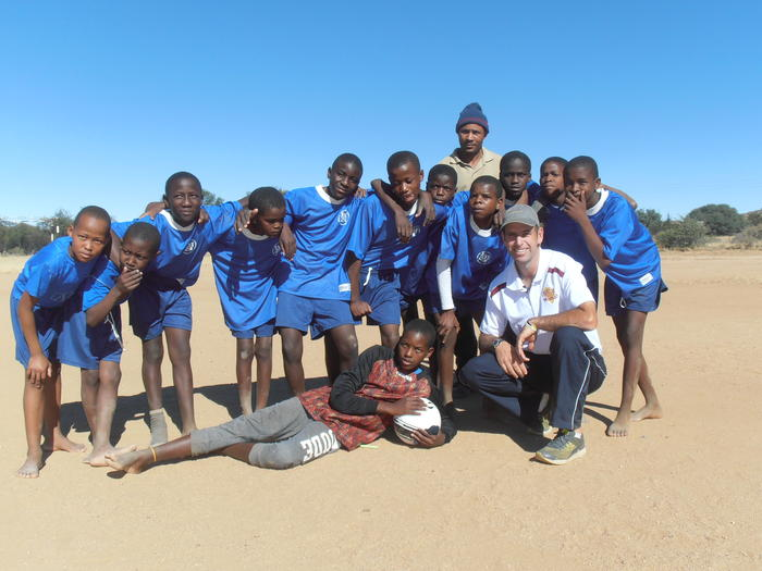 Matt Napier with a soccer team in Malawi who received some donated soccer balls.