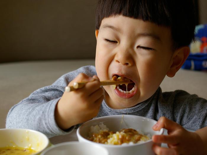 Boy eating natto