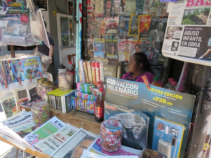 Where I go to buy a paper: Teresa at her newsstand.