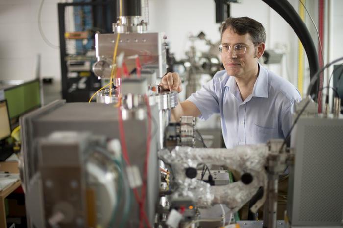 Professor Paul Dastoor with the scanning helium microscope