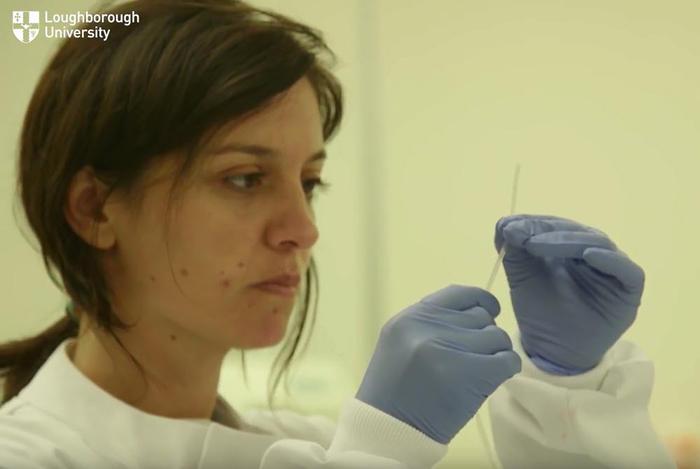 PhD researcher Ana Ferreira-Barbosa holds a microcapillary film.