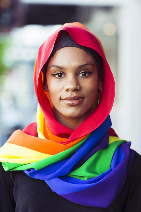 Model and writer Kalida Edwards wears the Pride scarf by MOGA