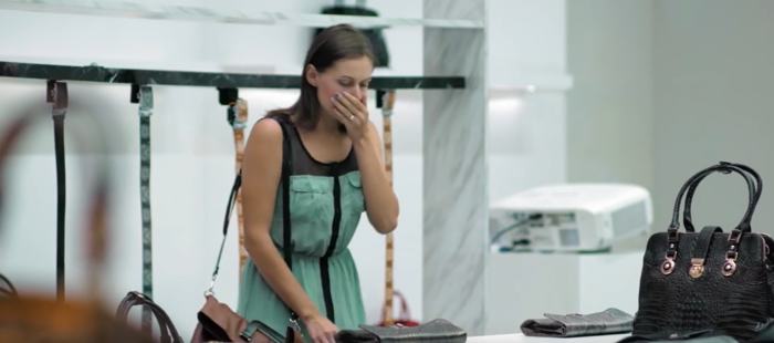 A woman recoils from one of the products. PETA.