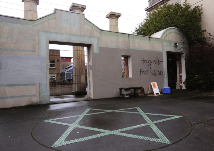 Anti-Semitic Holocaust-denying graffiti is seen on the facade of Temple De Hirsch Sinai in Seattle (USA) on March 10, 2017.