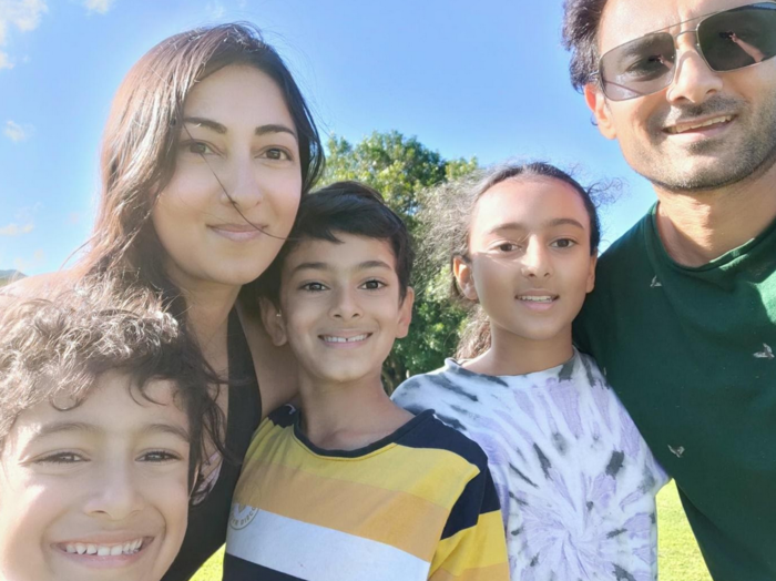 Seetha with her husband and children in Sydney.