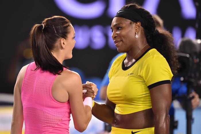 Serena Williams of the US (R) shakes hands with Poland's Agnieszka Radwanska
