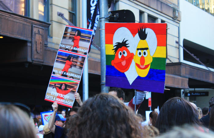 'Bert & Ernie' and 'Oprah' signs at Sydney Marriage Equality rally on September 10th, 2017. (Photo: Chloe Sargeant / SBS)
